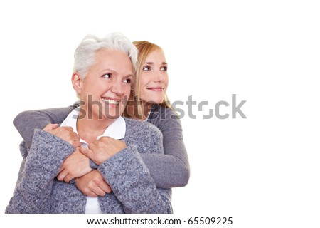 Grandmother and granddaughter looking together into the future - stock photo