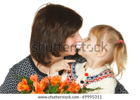 Grandmother and granddaughter nose to nose with a bunch of flowers isolated on white - stock photo