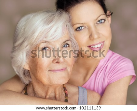 Grandmother and granddaughter portrait, embraced - stock photo