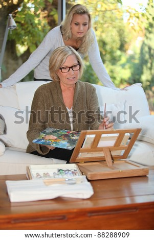grandmother and granddaughter spending time together at home - stock photo