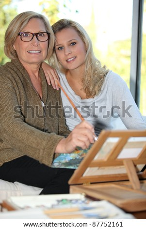 grandmother and granddaughter together at home - stock photo
