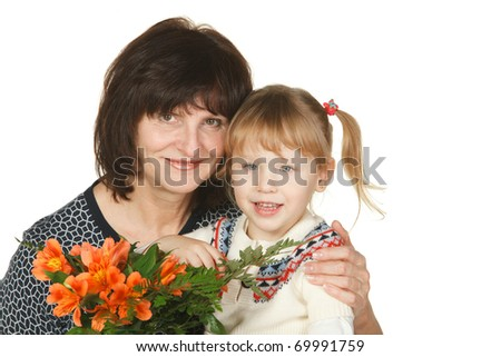 Grandmother and granddaughter with a bunch of flowers isolated on white - stock photo