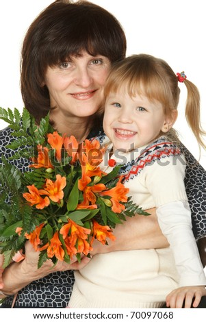 Grandmother and granddaughter with a bunch of flowers isolated on white
