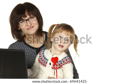 Grandmother and granddaughter with laptop isolated on white background - stock photo