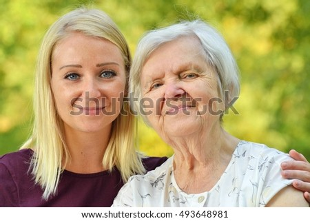 Grandmother and granddaughter. Young woman carefully takes care of an older woman. MANY OTHER PHOTOS WITH THIS SENIOR MODEL IN MY PORTFOLIO.