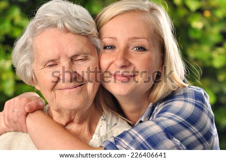 Grandmother and granddaughter. Young woman takes care of an elderly, senior woman. MANY OTHER PHOTOS FROM THIS SERIES IN MY PORTFOLIO.