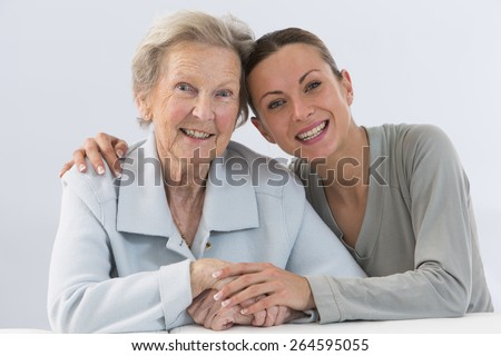 Grandmother and granddaughter. Young woman takes care of an elderly woman.