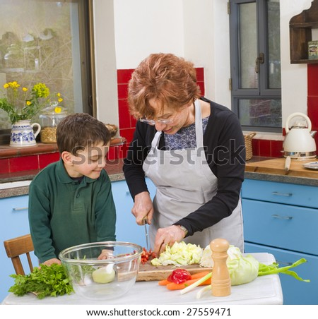 grandmother and grandson cooking in the kitchen - stock photo