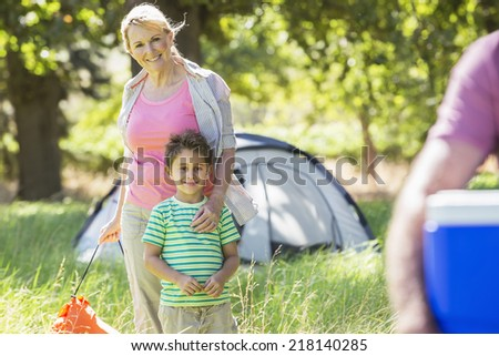 Grandmother And Grandson Enjoying Camping In Countryside