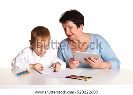 Grandmother and grandson learn the lessons ,  concept of family, education, new technologies