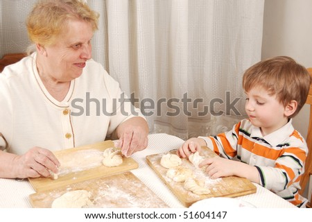 grandmother and grandson making buns