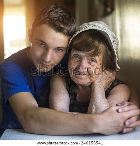 Grandmother and grandson portrait together in an embrace.  - stock photo
