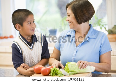 Grandmother And Grandson Preparing meal,mealtime Together - stock photo