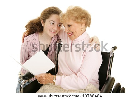 Grandmother and teen girl reading a get well card or mothers day card together.  Isolated on white. - stock photo