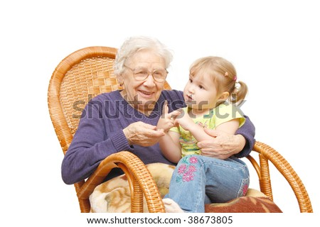 grandmother and the grand daughter in an armchair - stock photo