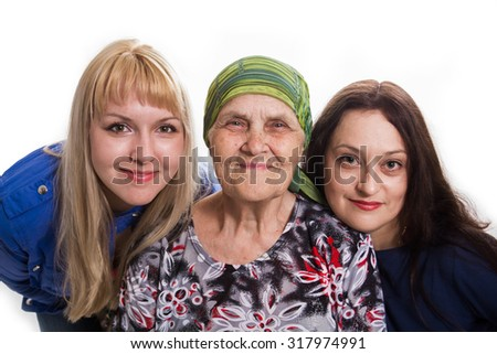 Grandmother both two granddaughters positive and happy, isolated. - stock photo