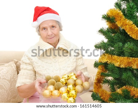 Grandmother decorates the Christmas tree toys - stock photo