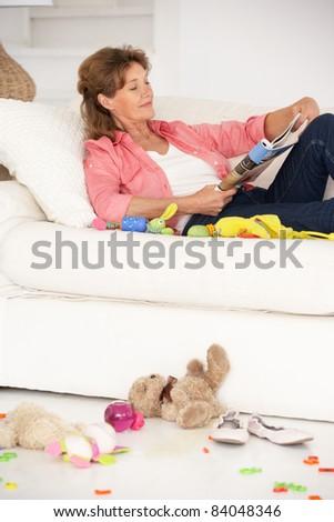 Grandmother enjoying a rest - stock photo