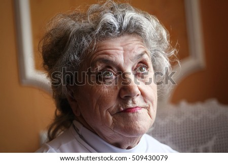 Grandmother face on a dark background