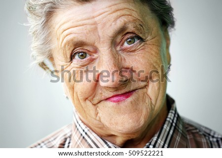 Grandmother face over grey