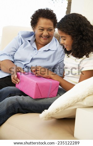 Grandmother Giving Present to Granddaughter - stock photo