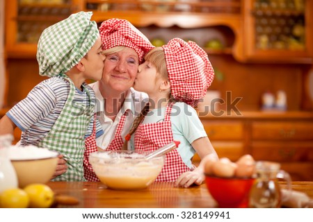 Grandmother,grandson And Granddaughter chef Baking In Kitchen - stock photo