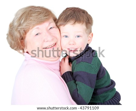Grandmother hugging handsome grandson isolated on white