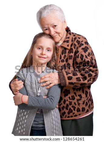 Grandmother hugging her granddaughter on a white background - stock photo