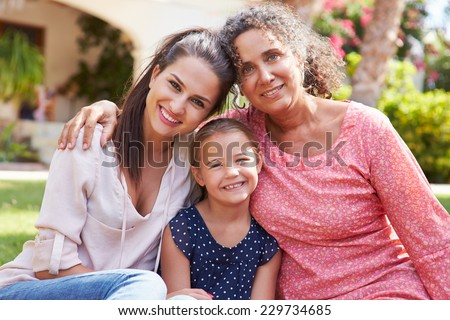 Grandmother In Garden With Daughter And Granddaughter - stock photo
