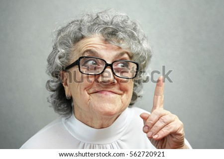 Grandmother in glasses points a finger up
