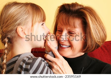 Grandmother laughing at a secret joke - stock photo