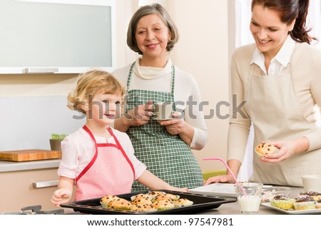 Grandmother, mother and child girl making cupcakes in kitchen - stock photo