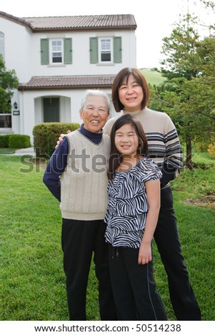 Grandmother, Mother, Daughter, Three Generations, Happy Family Portrait Outdoor in Front House - stock photo