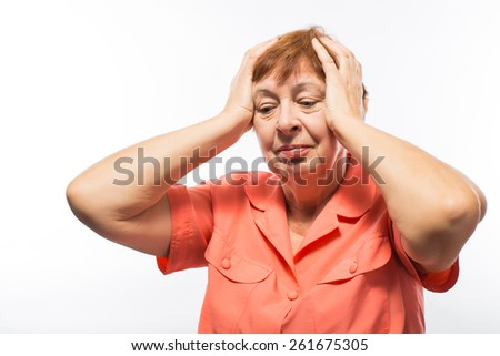 grandmother of her hand on his head - stock photo