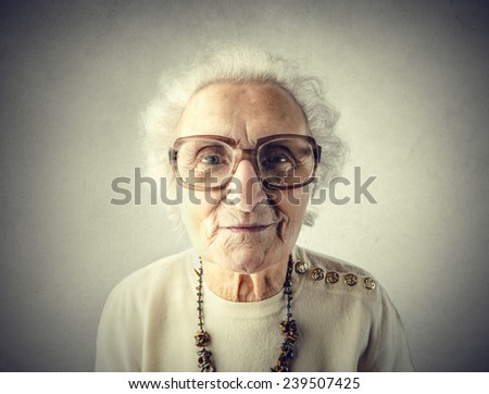 Grandmother overdressed herself  - stock photo