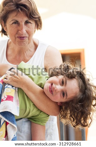 Grandmother playing with granddaughter - stock photo