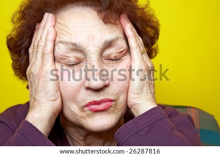 Grandmother portrait who had headache - stock photo