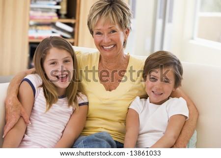 Grandmother posing with grandchildren - stock photo