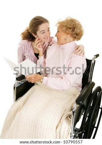 Grandmother receiving get well or mothers day card from granddaughter. Isolated on white. - stock photo