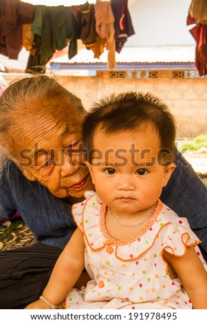 Grandmother share the moment with granddaughter . - stock photo