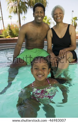 Grandmother, Son, and Granddaughter Together in Pool - stock photo