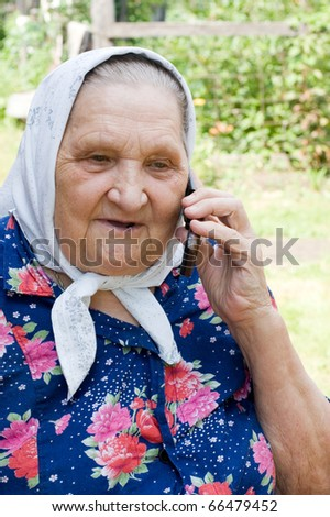 grandmother talking with a phone - stock photo