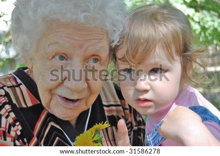grandmother tells a fairy tale to the grand daughter - stock photo