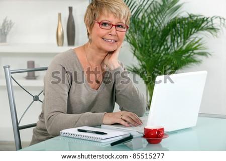 grandmother using laptop - stock photo