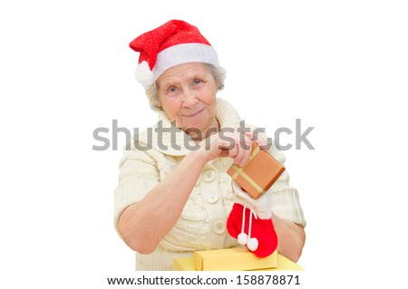 grandmother wearing Santa Claus hat with gift on white background - stock photo