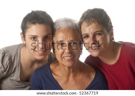 grandmother with adult daughter and granddaughter looking at camera - stock photo