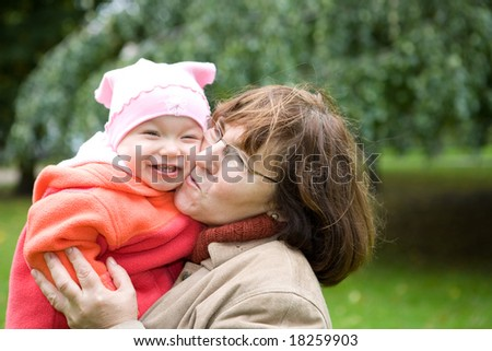 grandmother with baby girl together in park - stock photo