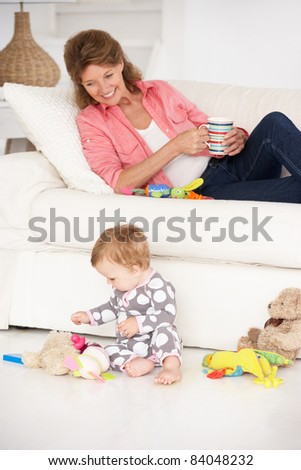 Grandmother with baby grandchild - stock photo