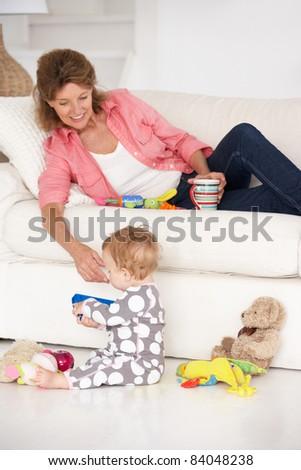 Grandmother with baby grandchild - stock photo