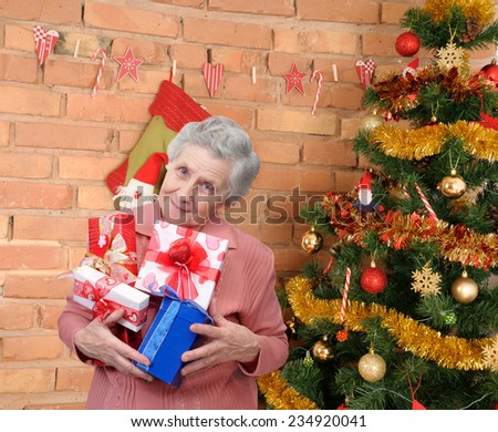 grandmother with gifts - stock photo